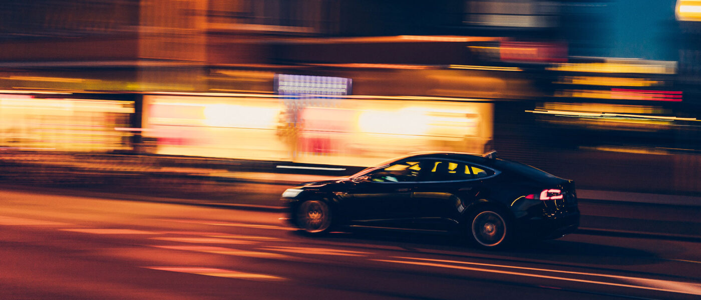 Car travelling fast along hight time street