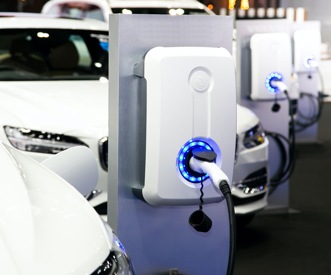 EV Chargers in a row with electric vehicles