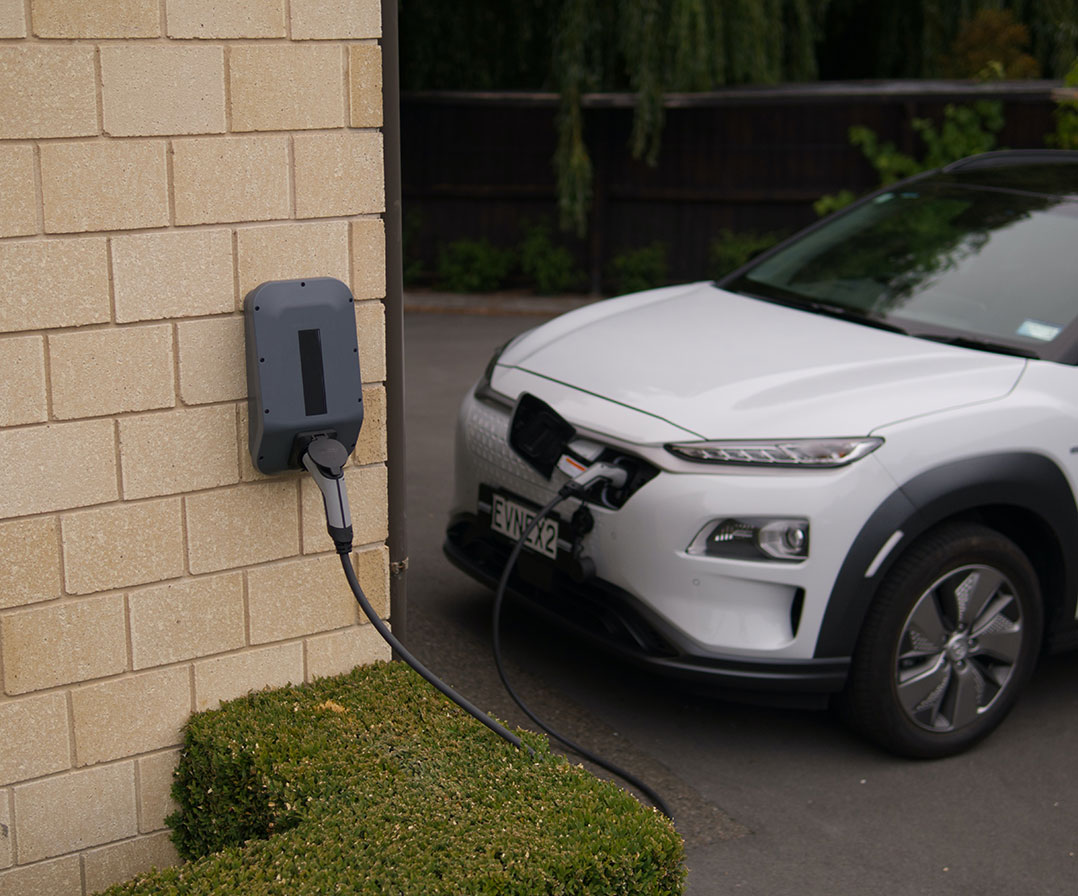 Electric Vehicle Charging outside house